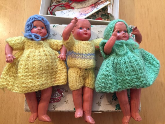 3 Vintage dolls in a box