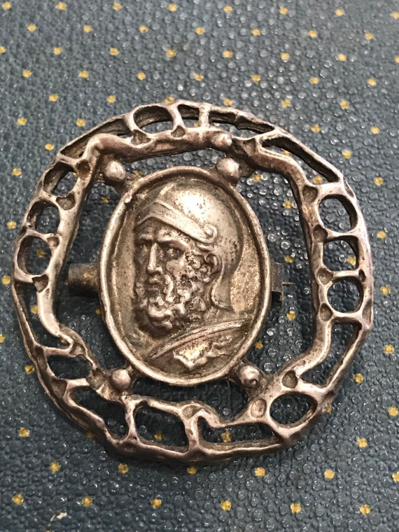Antique brooch showing a Roman emperors
