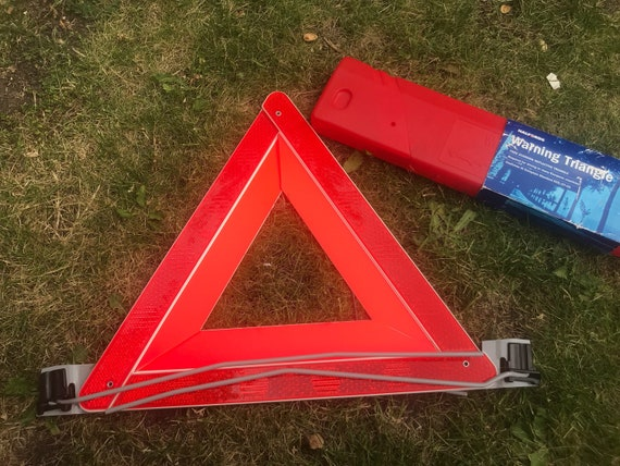Vintage roadside warning triangle in carry  case
