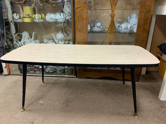 1960's Formica topped coffee table with black legs. Buyer to collect or arrange courier