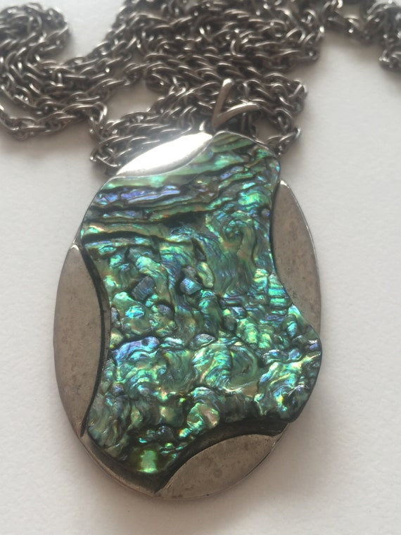 Mother of pearl pendant on a long chain