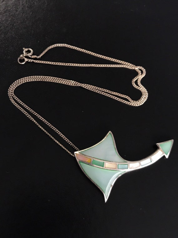 Silver sting ray necklace with gem stones