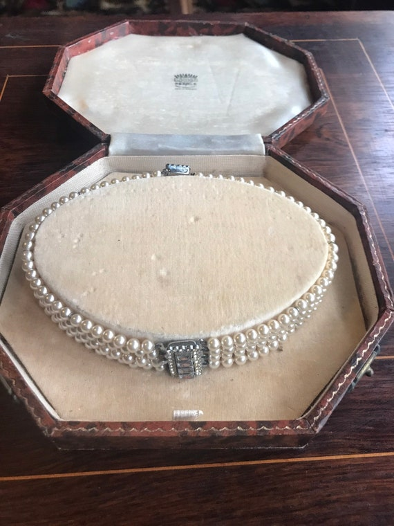 Stunning vintage Lotus pearl necklace in the original box/ seperates into two bracelets
