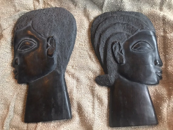 Ebony wooden  carvings of a man and womans face