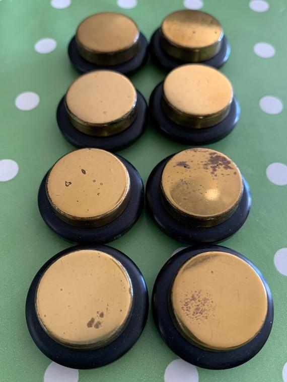 Set of eight vintage  buttons, gold metal set on a black jet