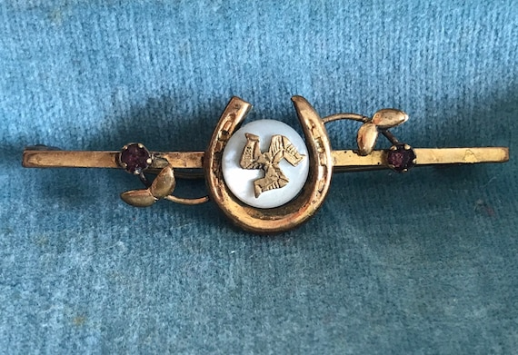 Goodluck brooch from The Isle of Man with gemstones