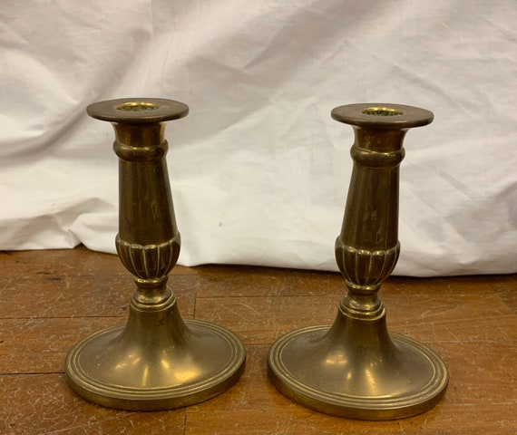 Pair of English Victorian brass candle sticks