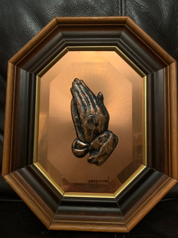 Copper art with praying hands