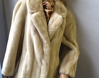 Vintage blonde faux fur jacket by Tissavel in France sold by C & A size 16