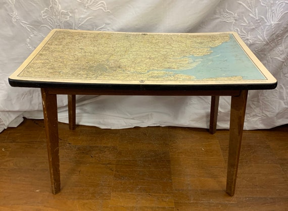 1960's Vintage table with London road map top. Buyer to collect