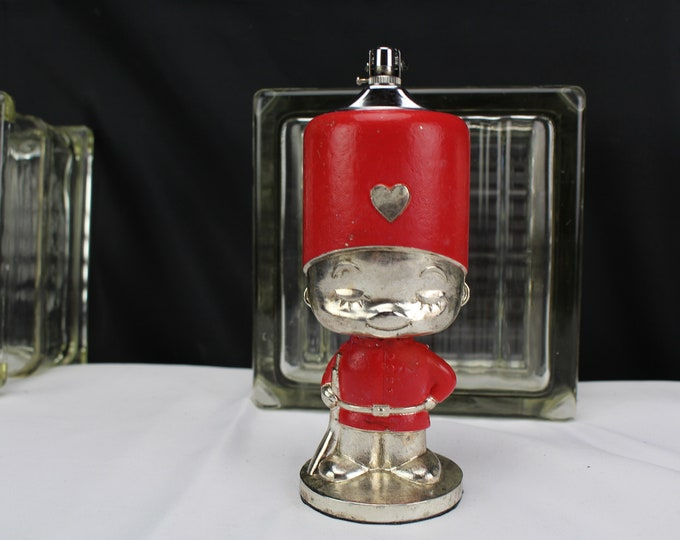 Vintage Table Lighter Figurine Boy British Guard Red and Chrome Tobacciana