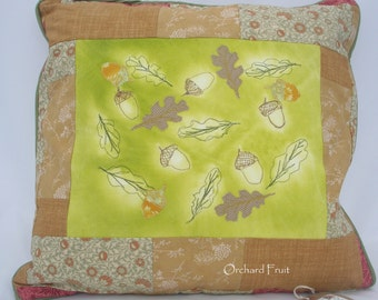 Autumn oak leaves and acorns cushion - embellished with sun printing, applique and free-motion embroidery