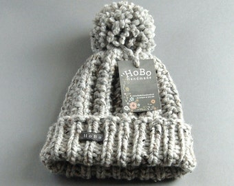 Womens Bobble Hat. Available in 9 Colours. HoBo Handmade thick chunky hand knitted beanie with large pom pom. Grey tweed wool blend XS to XL