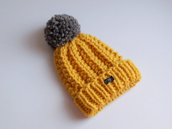 Mustard yellow and grey bobble hat with extra large pom pom.  899a18ea17c