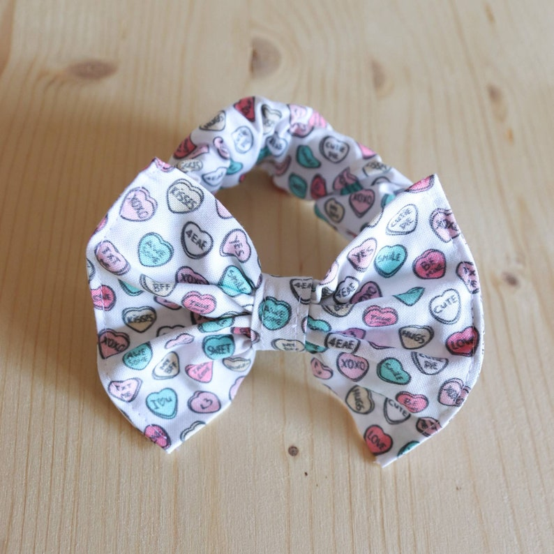Set of two hair elastics with SweetHeart Candy-themed bow