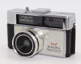 Halina Simplette Electric 126 Film Cartridge Camera + case – c. 1970 – with working winder and meter - Lomography