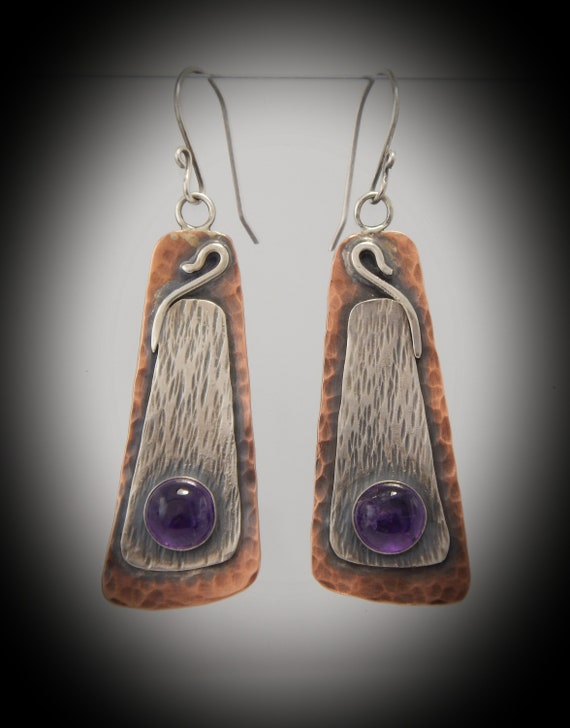 Handmade silver and copper earrings, adorned with amethyst and patinated