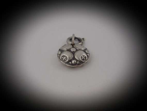 Sterling silver reversible charm (925)