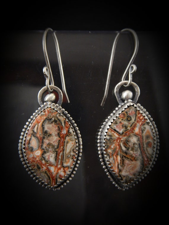 Sterling silver earring (925) and fine silver (999) patinated, handmade.   Adorned with a crazy lace agate