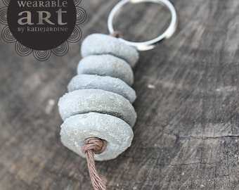 Cement to be - keyring - cement beads - cement - grey keyring
