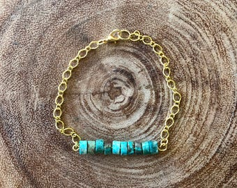 Turquoise beaded bracelet with gold plated chain.