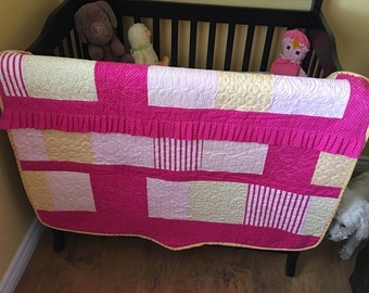 Ruffled pink quilt