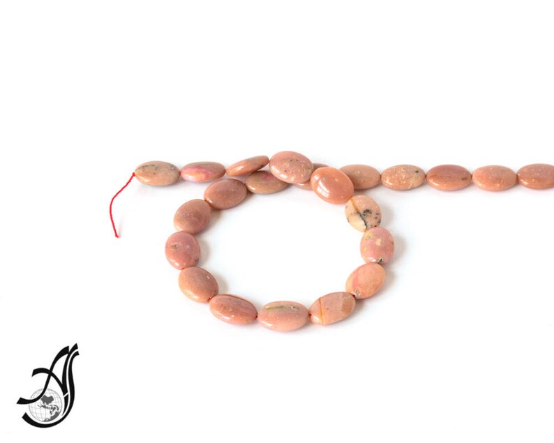 Pink Peruvian Opal Oval very creative. Calibrated 13x18 appx.,Pink,16inch full strand.One of a kind