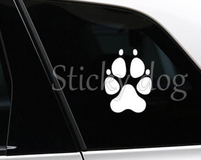 Dog paw silhouette sticker
