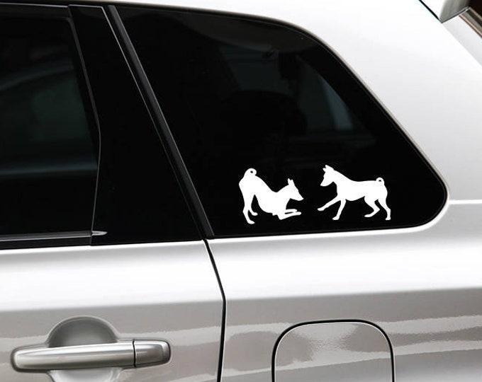 Basenji playing silhouette dog sticker