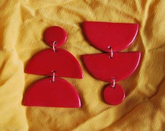 Bold Red Half-Moon Chandeliers