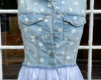 Upcycled recycled denim vest in light blue denim and white polka dots with crisp white on white embroidered cotton peplum.
