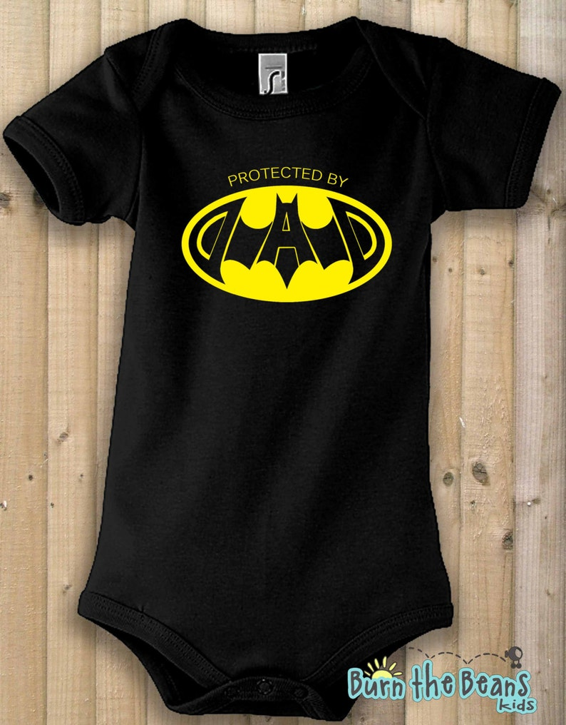 cce65fd16 Funny Onesie bodysuit batman protect by dad birthday gift | Etsy