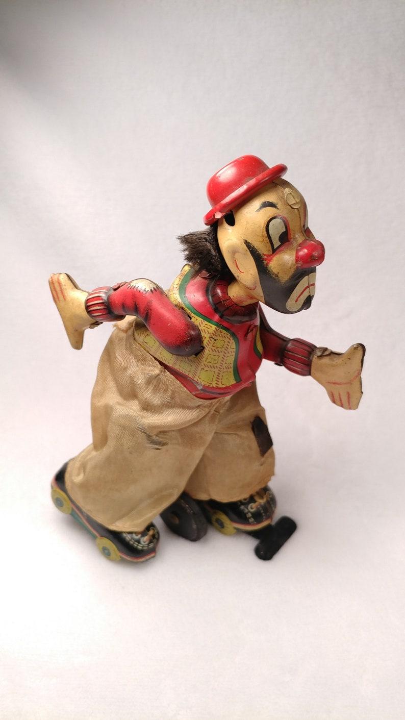 Vintage Tin toy windup Skating clown hobo