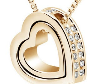 Gold or silver tone double heart necklace with chain.