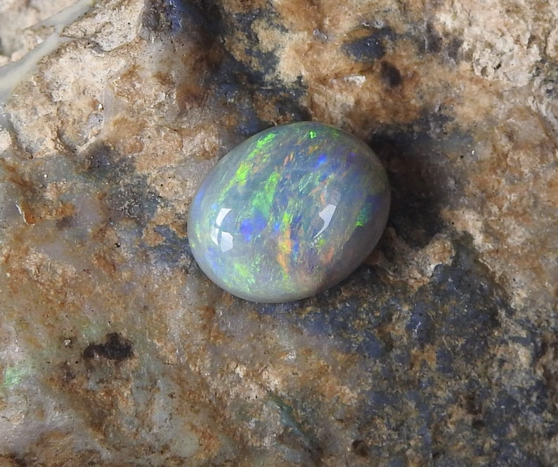 Natural Solid Polished Black Opal from Lightning Ridge with Multi-Color Fires.