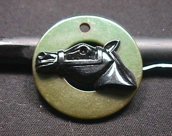 Vintage Bakelite ? a Green Cilrcle Pendant with a Black Horse Head Mounted in it's Center