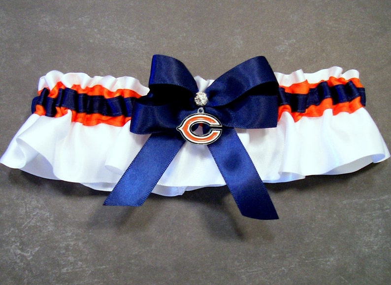 with a Chicago Bears\u00ae Enameled Charm Embellishment #FB9 May also be purchased individually Handmade Navy and Orange Wedding Garter Set