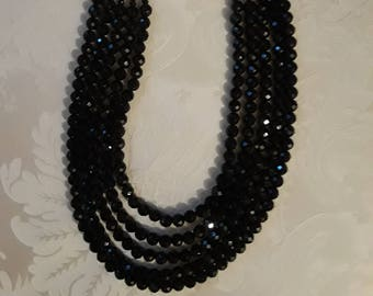 Five strand black faceted onyx necklace
