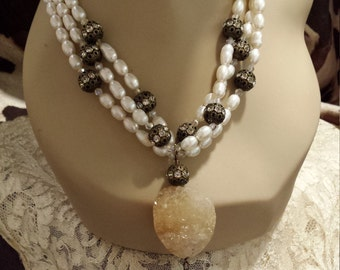 Three strand freshwater pearl necklace with center druzy drop