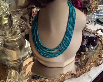 Six strand turquoise beaded necklace