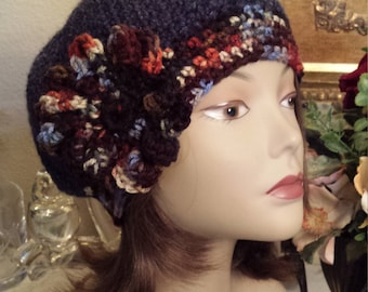 Winter crochet hat with flower on side