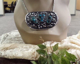 Sterling silver native American turquoise pendant