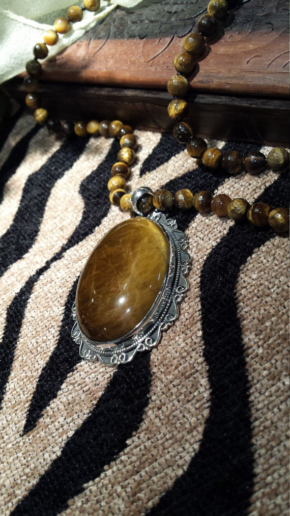 Sterling silver tiger eye pendant with tiger eye n
