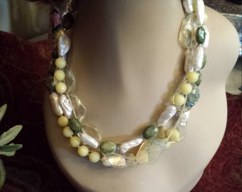 Three strand necklace made with assorted semi precious stones