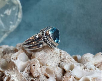 Sterling silver blue topaz ring, size 6