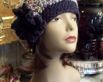 Winter hat with flower crochet and designed by petronella