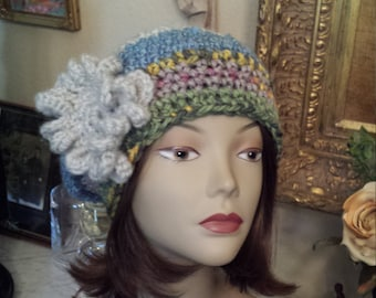 Winter hat with flower on side crochet and made by petronella