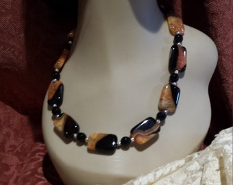one strand necklace made with orange and black onyx
