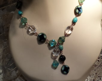 One strand necklace with center drop