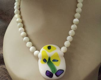 mother of pearl one strand necklace with center artist made pendant